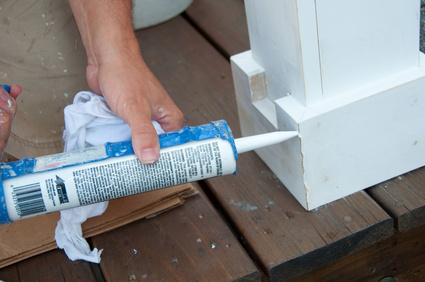 Painter Caulking Seam of Wood Trim